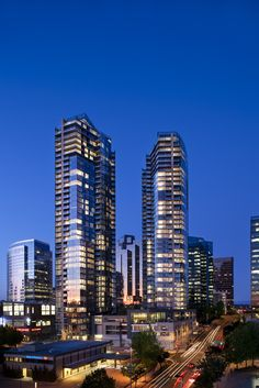 Bellevue Towers is a luxury high rise condominium building in downtown Bellevue, WA. View all Bellevue Towers condos for sale. Bellevue Park, Bellevue Washington, Washington State, Downtown Seattle, Seattle Skyline, Big Tree, Condos For Sale, Top Of The World, San Francisco Skyline