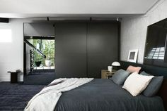 Beautiful bedrooms to inspire an update: Dark, sensuous and earthy tones prevail in this former shoe factory home in Melbourne.