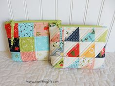Patchwork pouches with zipper tab pulls
