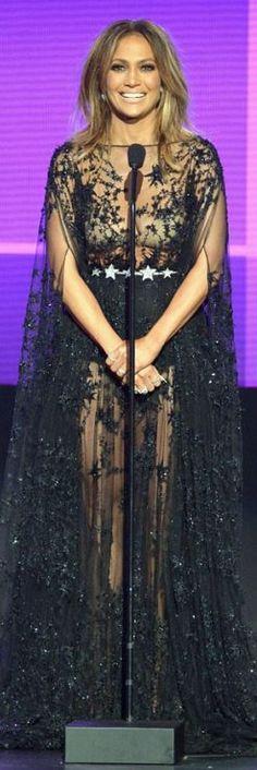 Who made Jennifer Lopez' black mesh gown?