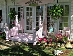 Penny's Vintage Home: Pretty Pink Back Porch ..... neat idea ~~ they have taken an antique bed and repurposed it into porch rails; also love the vintage ironing board over the french doors!