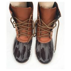 • Duck Boots • These gorgeous dark brown & tan waterproof duck boots will be sure to get you through the winter rain and snow! New in box, constructed with a rubber base and sole, lace up front, plaid inner lining, traction so you don't slip! Perfect to pair with skinny leggings or jeans!     PLEASE DO NOT PURCHASE THIS LISTING. Comment your size below and I'll make a new listing for you. Thank you! Jennifer's Chic Boutique Shoes Winter & Rain Boots
