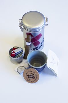 "The full ""Creativity Rescue Kit"" package: USB (with video and portfolio), tea, tea cup, cigar, matchbox and coaster."