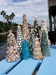 Pretty seashell Christmas cone trees with starfish toppers... (coastal Christmas, holidays, ocean, seashore, beach) https://www.etsy.com/listing/205396142/pearl-abalone-seashell-tree-with-knobby?utm_source=Pinterest&utm_medium=PageTools&utm_campaign=Share