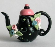 Miniature BLACK WHIMSY TEAPOT with FLOWERS  OOAK by ArtisticSpirit. I love this it is absolutely adorable. I can't wait to see how much this cost. I collect tea pots and just love them. I don have an artist on etsy that does a layaway policy and love her for it. tfs, hugs.