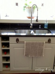 COTTAGE AND VINE: DIY Wine Storage & a New Faucet {Exactly what I need to do with the little space between the cabinets. Love the towel bar too}