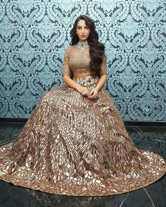 Nora Fatehi has been setting our screens on fire with her performances. But that's not it, she's also been busy giving us major outfit inspirations with her desi style. Here are 10 bridesmaid outfit inspirations by Nora Fatehi. Indian Fashion Dresses, Modest Fashion, Indian Outfits, Fashion Outfits, Ethnic Outfits, Bollywood Actress Hot Photos, Bollywood Fashion, Bollywood Stars, Bollywood Pictures