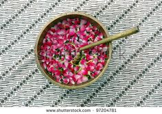 stock photo : flower petals in water with golden scoop in used in Javanese Indonesia  traditional wedding ceremony