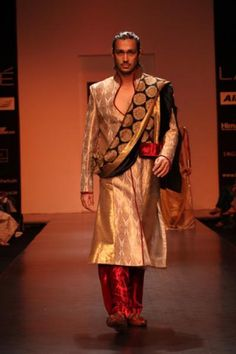 Amazing mix of earthy colors with brocade print. http://www.bollywoodshaadis.com/photo-gallery/latest-sherwani-trends-for-grooms/2096