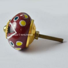 Dark Brownish Red Floral With Multi Polka Dots Ceramic Knobs, Set of 2 on RoyalFurnish.com, $3.97