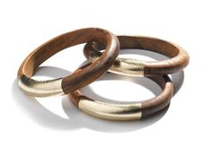 Whether worn as a trio or as stand alone pieces, these chic mango wood bangles feature an element of nature complemented by a sophisticated swatch of metallic leather. Add them to any outfit for a bold yet feminine touch. Set of 3. Each bracelet set includes a tag that shares information about the women who made this product.