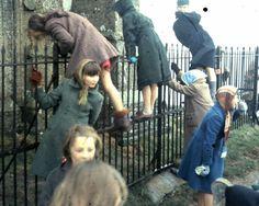 British children playing around the fence, ca. 1960s