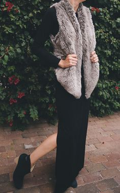 cozy faux fur vest with a black maxi dress