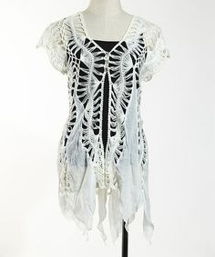 I just got this. It reminds me of spiderwebs, and I'm thinking it will go with a lot of my dresses. White Crochet Handkerchief Tunic on #zulily! #zulilyfinds