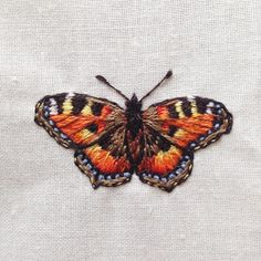 Small tortoiseshell butterfly complete! #tortoiseshellbutterfly #butterfly #embroidery #handbroidered #illustration #natureart #naturelovers #embroideredbutterfly #hoopart #insects #paintingwiththreads #threadart #handmade #natureart #naturalhistory #butterflycollection #butterflyspecimen #specimen #hedgerowdesign #fauxidermy