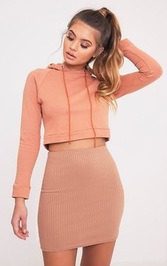 Camel Ribbed Mini Skirt Featuring athletic inspired, effortlessly sexy ribbed jersey fabric and ...