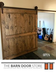 "#OpenBarnDoor Our Rio Verde customer needed an office door, which was very close to the foyer/entryway. What a perfect place to put a #barndoor!  **Barn Door Details**  Early American finish 6"" vintage wheels Rust hardware Cathedral Handle   #CustomBarnDoors #TheBarnDoorStore #MadeInUSA #Wood #Barns #HomeDecor #InteriorDesign #HomeRemodeling #DoorIdeas #Doors #MasterBedrooms #BathroomDoors"