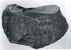 Statue fragment beariing incised cuneiform inscription of Amar-Sin.  Period: Ur III
