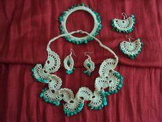 Crochet jewellery with fan design.