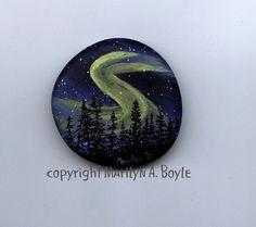 HAND PAINTED STONE; original art, scene, night, northern lights, aurora borealis, stars, fir trees, nature, wilderness,