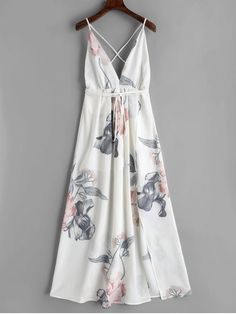 Floral Criss Cross Back Slit Maxi Dress. This gorgeous floral printed maxi dress should be your wardrobe essential. It features a barely open back with adjustable criss-cross spaghetti straps that tie around the waist and a slight overlay detail at the bottom with slit detailing and half lined for an added flirty look. Wear it with tan sandals for a perfect vacation trip. #Zaful #Dress #Outfits