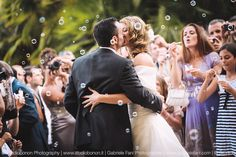 Stunning moment during ceremony of Arianna and Claudio for their wedding at Castello Odescalchi in Santa Marinella. Kissing with soap bubbles! Photo by Gabriele Fani Photographer.