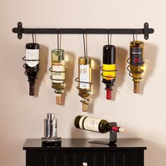 Garnish unused wall space and store your wine at the same time with this unique Harper Blvd wall mount wine rack. Five coil holders store bottles upside down, allowing your favorite labels to be visib