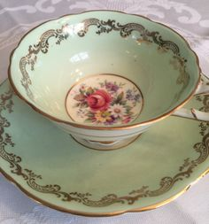 Vintage Paragon teacup and saucer set/ light greens teacup with florals/gilded cup by VintageSowles on Etsy