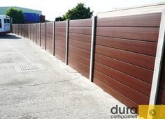 This Ipe Fence Is Supported By Steel Beams To Create A