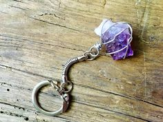 Wire wrapped Amethyst keychain Carry good vibes with you wherever you go with this wire wrapped raw gem keychain. I wrapped this 1.5 piece of Amethyst by hand using 20 gauge wire. Stone is attached to a 3 inch key chain. This keychain can be customized upon request.  Check out my other listings for quarts and citrine keychains