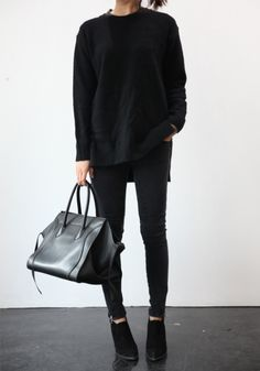 Try black on black. Black sweater, black skinny pants, black ankle boots, black tote