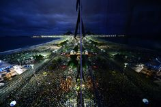 Thousands of young people gather at Rio de Janeiro's Copacabana beach to welcome Pope Francis to the World Youth Day ceremonies.
