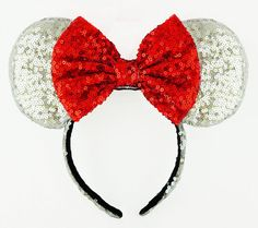 Sequin Minnie Mouse inspired Mickey ears headband bow! Wear it for a trip to your favorite theme park or cruise, birthday parties, photos and more. So So pretty!!! This headband has shiny sparkly sequin fabric all over the ears, and sequin fabric lining the headband. Plus the matching bow has sequins too! This is truly a showstopper! Bow: Red. Ears + Headband: Silver Shiny Sequin fabric. Fits: Girls to adults.