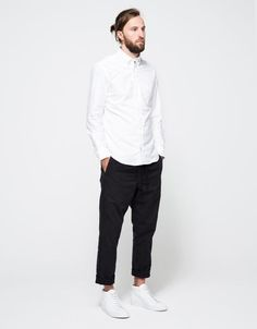 A simple look every man can try . White shirt, black pant & white sneakers