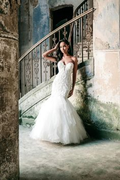 Sparkling beaded floral appliques trail across the dramatic neckline and illusion back of this strapless fit and flare gown. Stunning Wedding Dresses, Princess Wedding Dresses, Perfect Wedding Dress, Bridal Wedding Dresses, Wedding Dress Styles, Bridesmaid Dresses, Bridal And Formal, Sophisticated Bride, Boho Bride