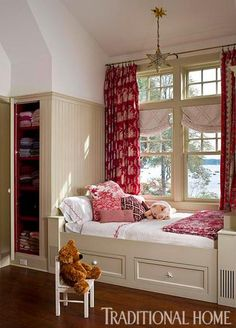 This child's bedroom features a built-in window seat bed with storage below - Traditional Home® / Photo: Bruce Buck / Design: Eliza Gatfield