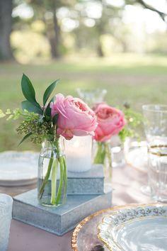 Tea roses and books.  Floral Design: Charleston Flower Market - Catherine Davis. Photography: Stefanie Kapra Photography - www.stefaniekapraphoto.com  Read More: http://www.stylemepretty.com/2014/06/11/charming-plantation-wedding-inspiration-shoot/