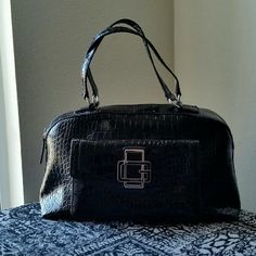 GUESS......BEAUTIFUL PATENTED..HANDBAG. ...EXCELLENT CONDITION....NWOT. ...BRAND NEW ...NO FLAWS ...BEAUTIFUL  ...true to its color and size  ...2 pic up close ...AUTHENTIC... GUESS... ...PATENTED STYLE THROUGHOUT  ...crocodile design.. ...logo on front ...front pocket design ...plenty of room inside  ...zipper pocket inside  ...2 small compartments  ...4 pic shows ..no flaws . ...better in person. ...MEASUREMENTS. ..15 X. 9 X .7X Guess Bags