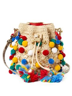 This season, Dolce & Gabbana's warm-weather accessories are accented with pompoms, gold coins and enamel flowers – and are all the better for it. This natural raffia crocheted Claudia bucket bag is finished with a luxe leather drawstring and two snake-effect straps. Amp up the drama with one of the label's exuberant sundresses.