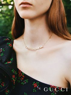 """Discover more gifts from the Gucci Garden by Alessandro Michele. A necklace in 18k yellow gold with heart charms and the phrase """"L'Aveugle Par Amour"""" which translates to """"Blind for Love."""""""