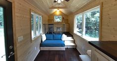Sleeping lofts in tiny houses can be uncomfortable. This studio-style home on wheels gets rid of it entirely.