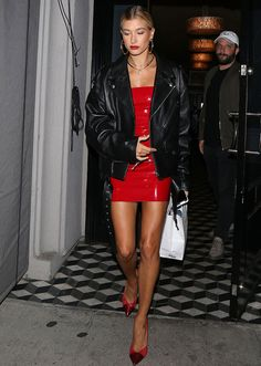 STYLECASTER | Hailey Baldwin Best Street Style Guide | mini red patent dress and oversized black leather jacket