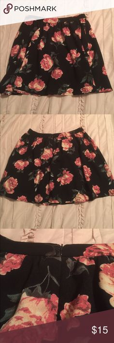Floral Skater Skirt This floral skater skirt was worn once and is in great condition. It has a black background with pink flowers. Skirts Circle & Skater