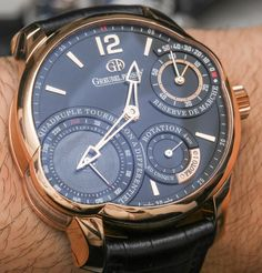Hands-on review & original photos of the Greubel Forsey Quadruple Tourbillon Secret watch with price, background, specs, & expert analysis.
