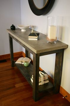 Console table with concrete top and ebony stain base