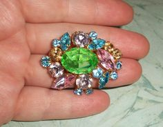 "Vintage Colorful Rhinestone Brooch,1 5/8"" by 1.25"" oval,rhinestones,green,pink,blue,amber,lavender,gold tone backing,pin,old,cluster,flowers by PhoenixAndFoxShop on Etsy"