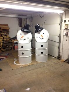Barrel snowmen. Snowmen have small tires for the hat brim and buckets for the tops. Bottle caps for the eyes, nose and mouths. Canning jar seals for buttons that are painted black. They put small branches on for the arms as well.