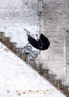 Graffiti by Banksy. Unlike allot of other street artists, Bansky seems to have a political message regarding society. Where's the adult pushing the baby carriage ? In Day Care ?