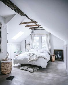 white rustic bedroom on the attic