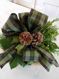 My favorite plaid ribbon, golden juniper, eucalyptus pods and lemon leaves decorate a package wrapped in brown paper bags.
